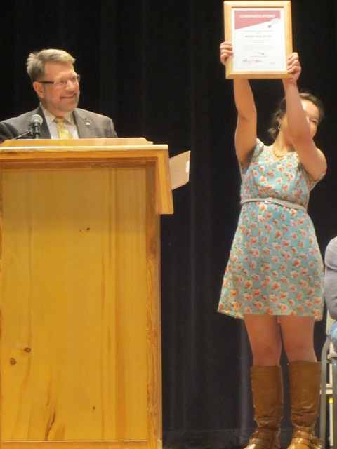 Martina Brown receives the Gates Scholarship Award from her teacher/mentor Robert McClory